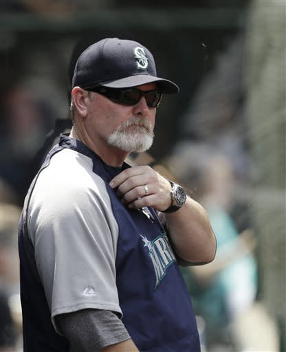 Seattle Mariners head coach Eric Wedge watches in the fourth inning of a baseball game against the Cleveland Indians, Sunday, May 19, 2013, in Cleveland. (AP Photo/Tony Dejak)