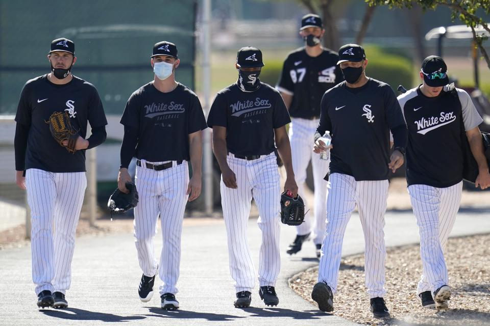 Chicago White Sox players walk to another field during a spring training baseball practice Wednesday, Feb. 24, 2021, in Phoenix. (AP Photo/Ross D. Franklin)