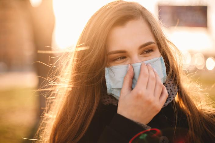 We've rounded up where to buy reusable cotton face masks with nose wire. Some even include filters and filter pockets. (Photo: finwal via Getty Images)