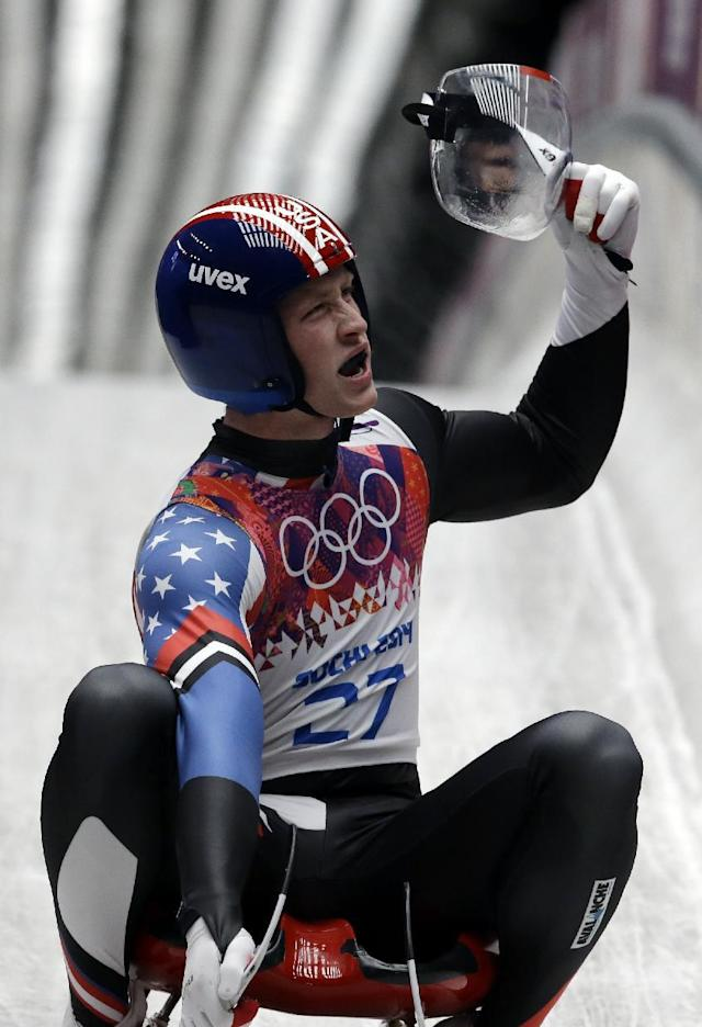 Aidan Kelly of the United States brakes in the finish area after his second run during the men's singles luge competition at the 2014 Winter Olympics, Saturday, Feb. 8, 2014, in Krasnaya Polyana, Russia. (AP Photo/Dita Alangkara)