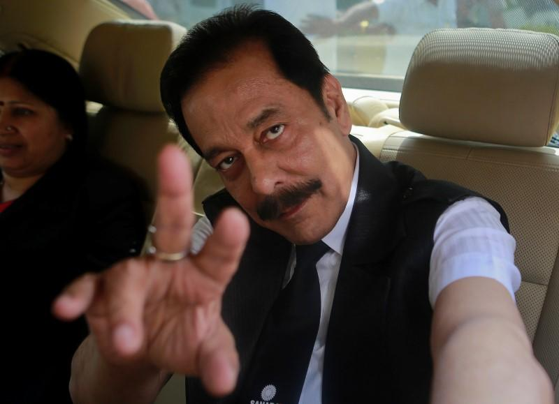 File photo of Sahara Group Chairman Subrata Roy gesturing as he arrives at the Securities and Exchange Board of India headquarters in Mumbai