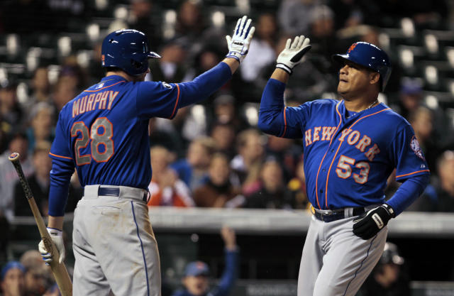 New York Mets' Daniel Murphy (28) congratulates Mets' Bobby Abreu (53) after Abreu scored in the eighth inning of a baseball game against the Colorado Rockies in Denver, Thursday, May 1, 2014. (AP Photo/Joe Mahoney)