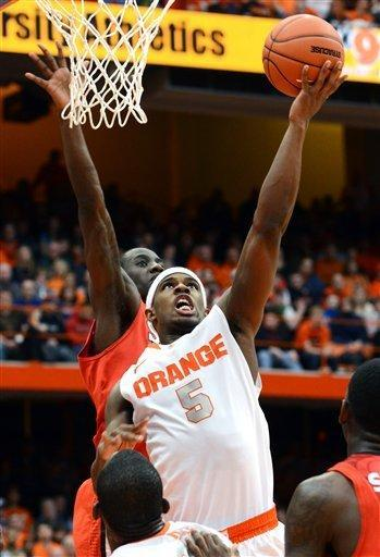 Syracuse's C.J. Fair (5) shoots against St. John's during the second half of an NCAA college basketball game in Syracuse, N.Y., Sunday, Feb. 10, 2013. Syracuse won 77-58. (AP Photo/Kevin Rivoli)