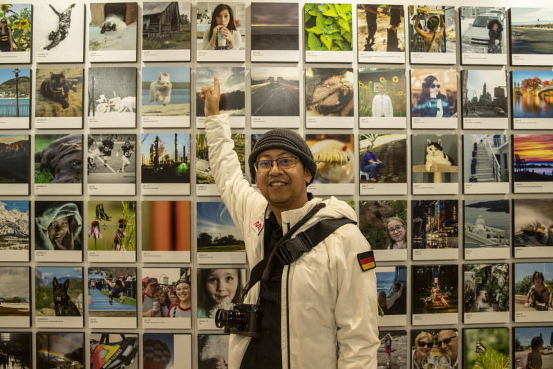 Photographer Johnny L. points toward his photo selected to be in the exhibit. (Photo: Gordon Donovan/Yahoo News)