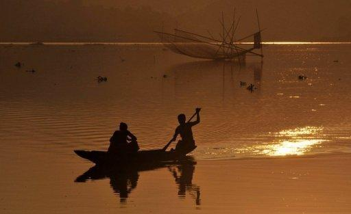 """Fishermen on the Brahmaputra River near Panikhati village in Guwahati City, September 2011. Water levels of a major river flowing through India's northeast are """"normal,"""" an Indian government official said Friday, denying claims a dam in neighbouring China had caused them to plunge"""