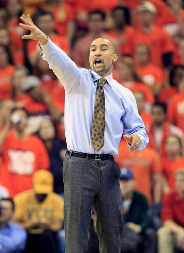 Virginia Commonwealth head coach Shaka Smart directs his team during the first half of an NCAA college basketball game against Virginia in Charlottesville, Va., Tuesday, Nov. 12, 2013. (AP Photo/Steve Helber)