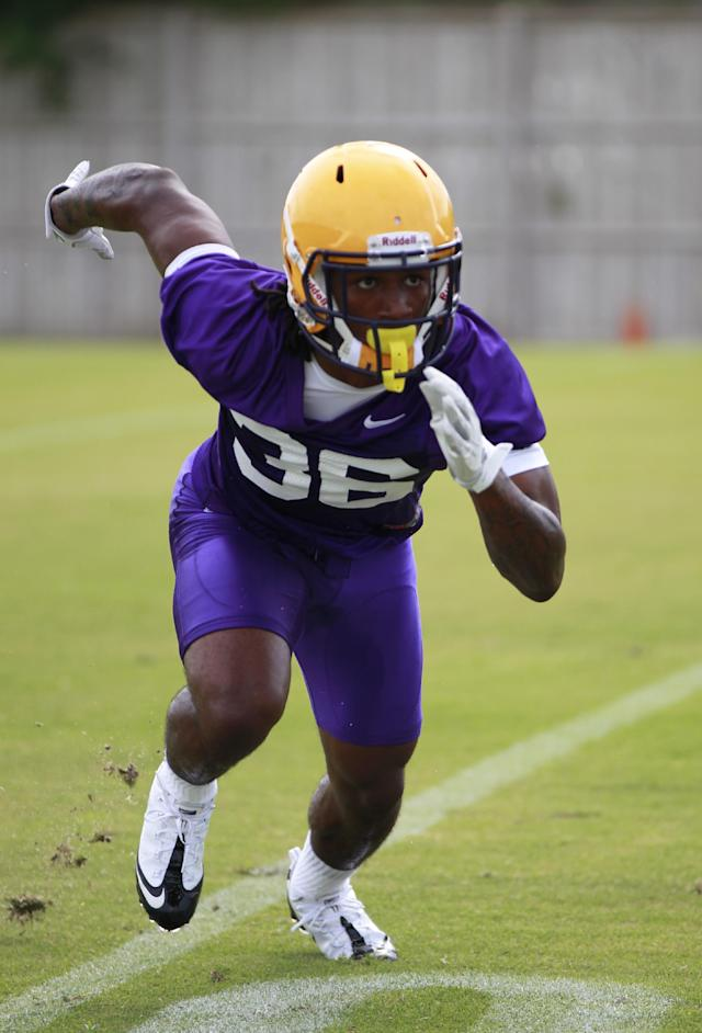 LSU cornerback Jalen Mills (36) works out during NCAA college football practice in Baton Rouge, Thursday, Aug. 2, 2012. (AP Photo/Gerald Herbert)