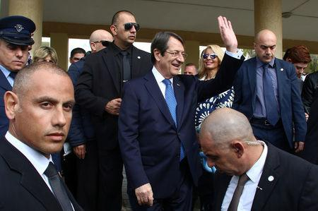 Presidential candidate Nicos Anastasiades leaves the voting center after casting his ballot, during the second round of the presidential election in Limassol, Cyprus February 4, 2018. REUTERS/Yiannis Kourtoglou