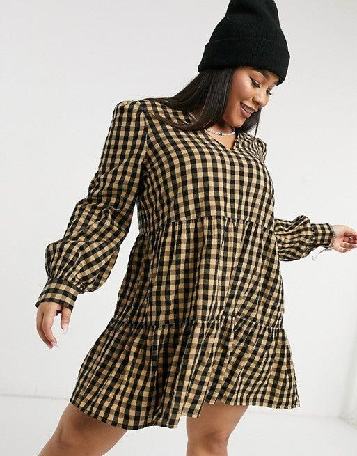 """<h2>ASOS Collusion Gingham Trapeze Dress</h2><br>A thorough hunt for the best of a white-hot trend always involves a pit stop at ASOS — the affordable UK-based retailer consistently offers the most up-to-the-minute styles, and our readers know not to hesitate when there's something appealing in stock. (Inventory has a tendency to sell out with shocking velocity.) Our winning pick is a tiered tent dress with cold-weather-ready long sleeves and a fall-friendly gingham colorway, show here in sizes 0 - 24.<br><br><strong>Collusion</strong> Plus size v-neck trapeze dress in seersucker gingham, $, available at <a href=""""https://go.skimresources.com/?id=30283X879131&url=https%3A%2F%2Fwww.asos.com%2Fus%2Fcollusion%2Fcollusion-plus-v-neck-trapeze-dress-in-seersucker-gingham%2Fprd%2F20587061"""" rel=""""nofollow noopener"""" target=""""_blank"""" data-ylk=""""slk:ASOS"""" class=""""link rapid-noclick-resp"""">ASOS</a><br><br><strong>Collusion</strong> V neck trapeze dress in seersucker gingham, $, available at <a href=""""https://go.skimresources.com/?id=30283X879131&url=https%3A%2F%2Fwww.asos.com%2Fus%2Fcollusion%2Fcollusion-v-neck-trapeze-dress-in-seersucker-gingham%2Fprd%2F20587066"""" rel=""""nofollow noopener"""" target=""""_blank"""" data-ylk=""""slk:ASOS"""" class=""""link rapid-noclick-resp"""">ASOS</a>"""