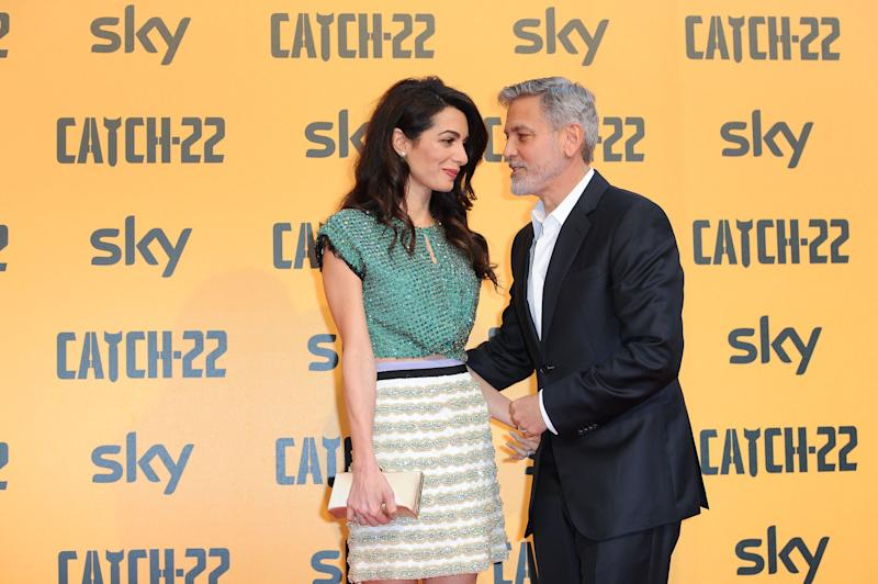 American actor George Clooney and his wife, Lebanese lawyer Amal Clooney attend the premiere of the Sky TV serie Catch-22.