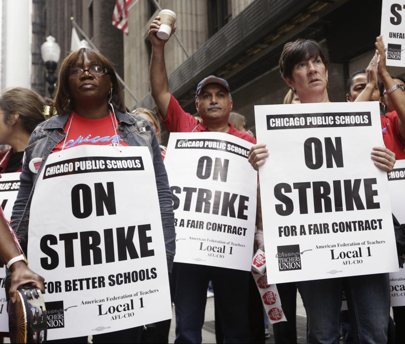 Chicago Teachers Union members listen to an update about negotiations on the fourth day of their strike on Sept. 13, 2012.  (John Gress/Reuters)