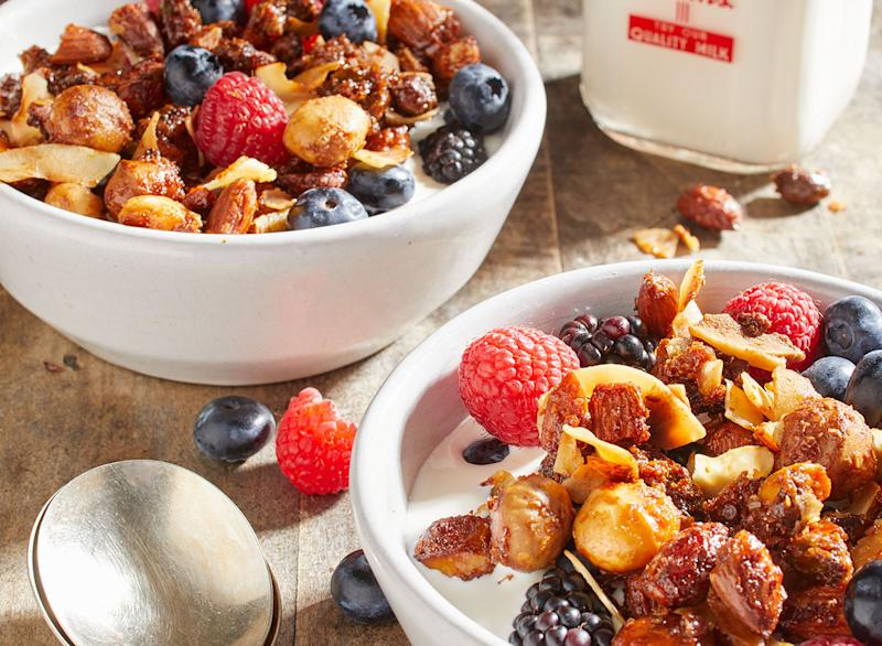 Keto nut and granola recipe in a bowl with fruit and milk