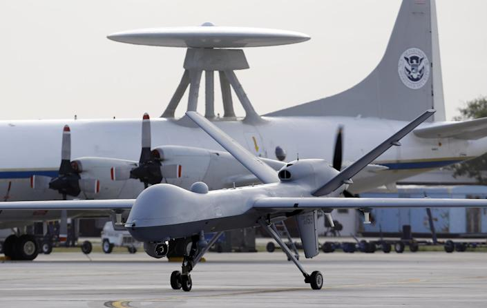 FILE - This Nov. 8, 2011 file photo shows a Predator B unmanned aircraft taxis at the Naval Air Station in Corpus Christi, Texas. The White House has no intentions to end CIA drone strikes against militant targets on Pakistani soil, setting the two countries up for diplomatic blows after Pakistani's parliament unanimously approved new guidelines for the country in its troubled relationship with the US, US and Pakistani officials say. (AP Photo/Eric Gay, File)