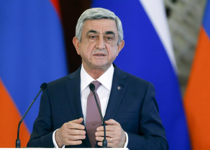 FILE- In this file photo taken on Wednesday, March 15, 2017, Armenian President Serge Sarkisian speaks to the media after talks with Russian President Vladimir Putin in the Kremlin in Moscow, Russia. Armenians are set to cast ballots Sunday in the first parliamentary elections since the ex-Soviet nation modified its constitution to expand powers of parliament and prime minister. (Sergei Chirikov/Pool Photo via AP, file)