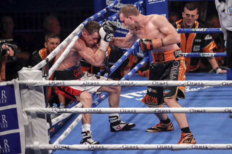 Jeff Horn of Australia, right, punches Britain's Gary Corcoran as he falls into the ropes during their WBO Welterweight title fight in Brisbane, Australia, Wednesday, Dec.13, 2017. Horn followed up his contentious WBO welterweight title win over Manny Pacquiao with a successful first defense on Wednesday against Gary Corcoran. (Glenn Hunt/AAP Image via AP)