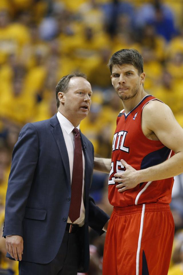 INDIANAPOLIS, IN - MAY 3: Atlanta Hawks head coach Mike Budenholzer talks with Kyle Korver #26 during a timeout against the Indiana Pacers during Game Seven of the Eastern Conference Quarterfinals of the 2014 NBA Playoffs on May 3, 2014 at Bankers Life Fieldhouse in Indianapolis, Indiana. NOTE TO USER: User expressly acknowledges and agrees that, by downloading and or using this photograph, User is consenting to the terms and conditions of the Getty Images License Agreement. (Photo by Joe Robbins/Getty Images)