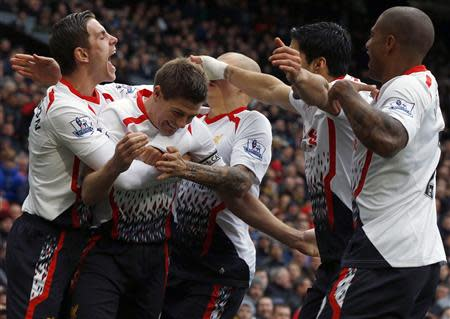 Liverpool's Steven Gerrard (2nd L) celebrates scoring his second penalty against Manchester United with team mates during their English Premier League soccer match at Old Trafford in Manchester, northern England, March 16, 2014. REUTERS/Phil Noble