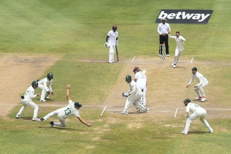 Wiaan Mulder catches Joshua da Silva to conmplete the third wicket in Keshav Maharaj's hat-trick as the spinner became only the second South African to achieve the feat in Test cricket