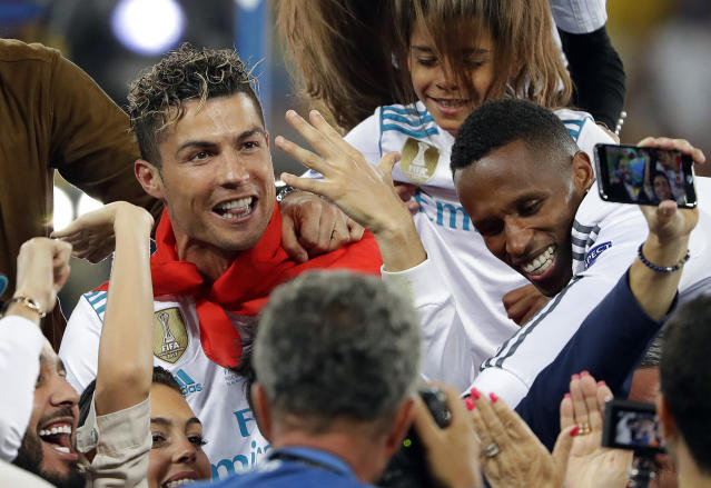 FILE - In this Saturday, May 26, 2018 file photo Real Madrid's Cristiano Ronaldo celebrates with fans after winning the Champions League Final soccer match between Real Madrid and Liverpool at the Olimpiyskiy Stadium in Kiev, Ukraine. (AP Photo/Sergei Grits, File)