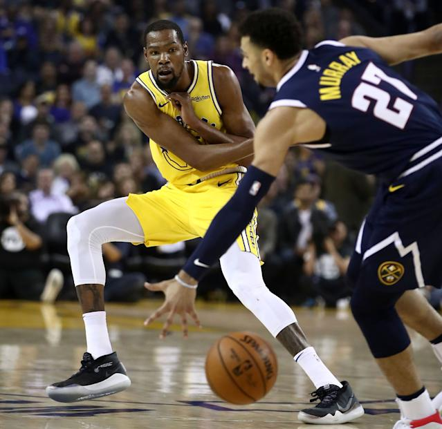 Kevin Durant passes the ball against the Nuggets on Tuesday night. (Getty Images)