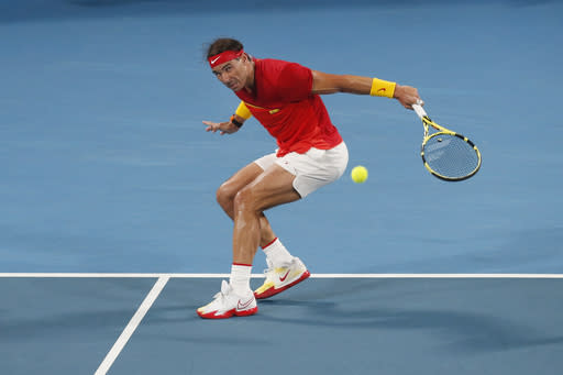 Rafael Nadal of Spain plays a shot against Novak Djovovic of Serbia during their ATP Cup tennis match in Sydney, Sunday, Jan. 12, 2020. (AP Photo/Steve Christo)