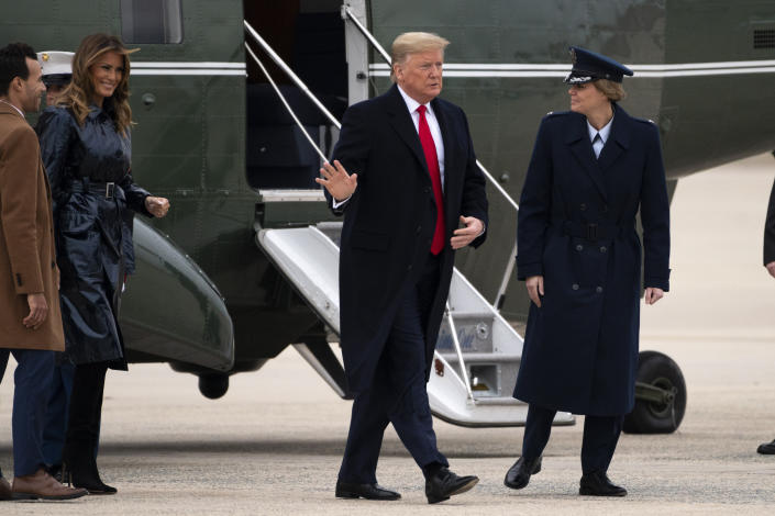 President Donald Trump and first lady Melania Trump exit Marine One on Monday, Jan. 13, 2020, at Andrews Air Force Base, Md., as he travels to attend the College Football National Championship game in New Orleans. (AP Photo/Kevin Wolf)