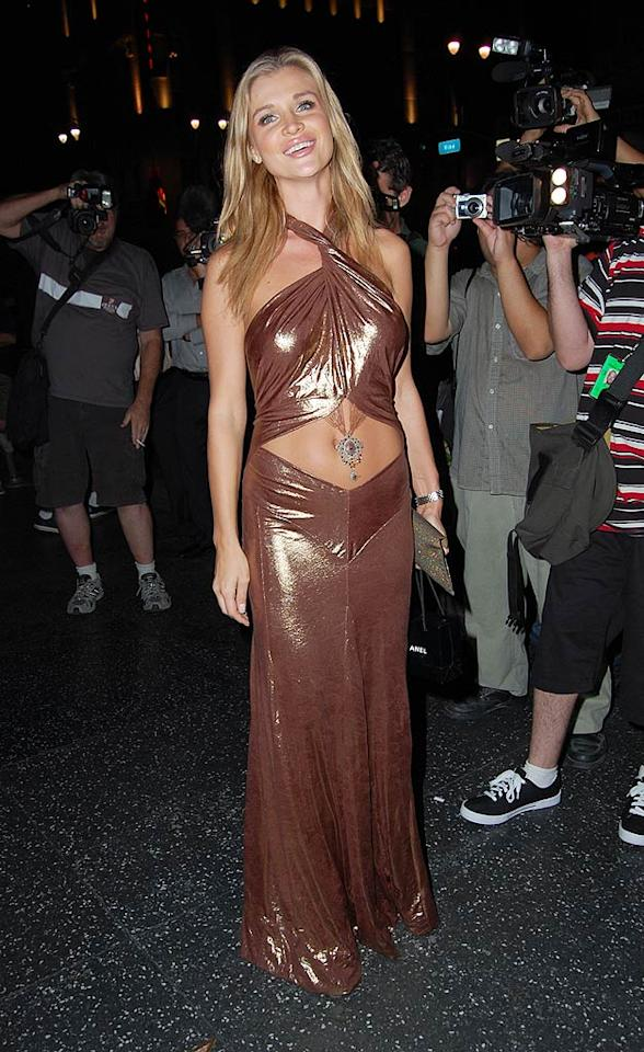 "Belly-baring ensembles tend to be tacky. Case in point: this cheap-looking gown Joanna Krupa wore to Katsuya. JCalderon/<a href=""http://www.splashnewsonline.com"" target=""new"">Splash News</a> - August 6, 2009"