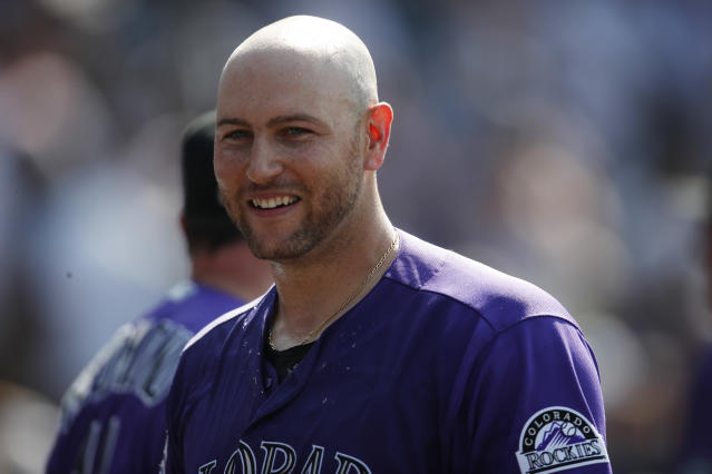 Colorado Rockies' Chris Iannetta smiles after drawing a bases-loaded walk against Los Angeles Dodgers relief pitcher Dylan Floro to force in the winning run in the ninth inning of a baseball game Sunday, Aug. 12, 2018, in Denver. (AP Photo/David Zalubowski)