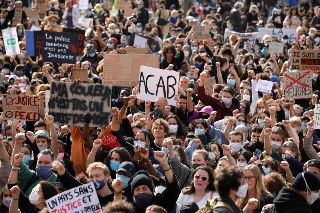 Protesters march on the Champ de Mars on Saturday. (Geoffroy Van der Hasselt/AFP)
