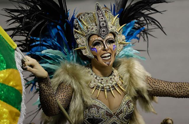 <p>A dancer from the Unidos do Peruche samba school performs during a carnival parade in Sao Paulo, Brazil, Saturday, Feb. 10, 2018. (Photo: Andre Penner/AP) </p>