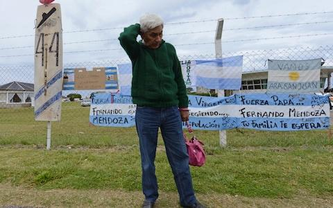 Juan Carlos Mendoza, father of Fernando Mendoza, a crew member of the missing submarine ARA San Juan, stands outside the Navel base in Mar del Plata, Argentina waiting for news - Credit: AP