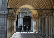 Officers patrol the streets of Venice, which saw some stringent lockdown measures eased this week