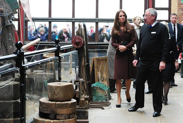 GRIMSBY, ENGLAND - MARCH 05: Catherine, The Duchess of Cambridge talks to former trawler-man John Vincent (R) during her tour of the National Fishing Heritage Centre on March 5, 2013 in Grimsby, England. (Photo Anna Gowthorpe - WPA Pool/Getty Images)