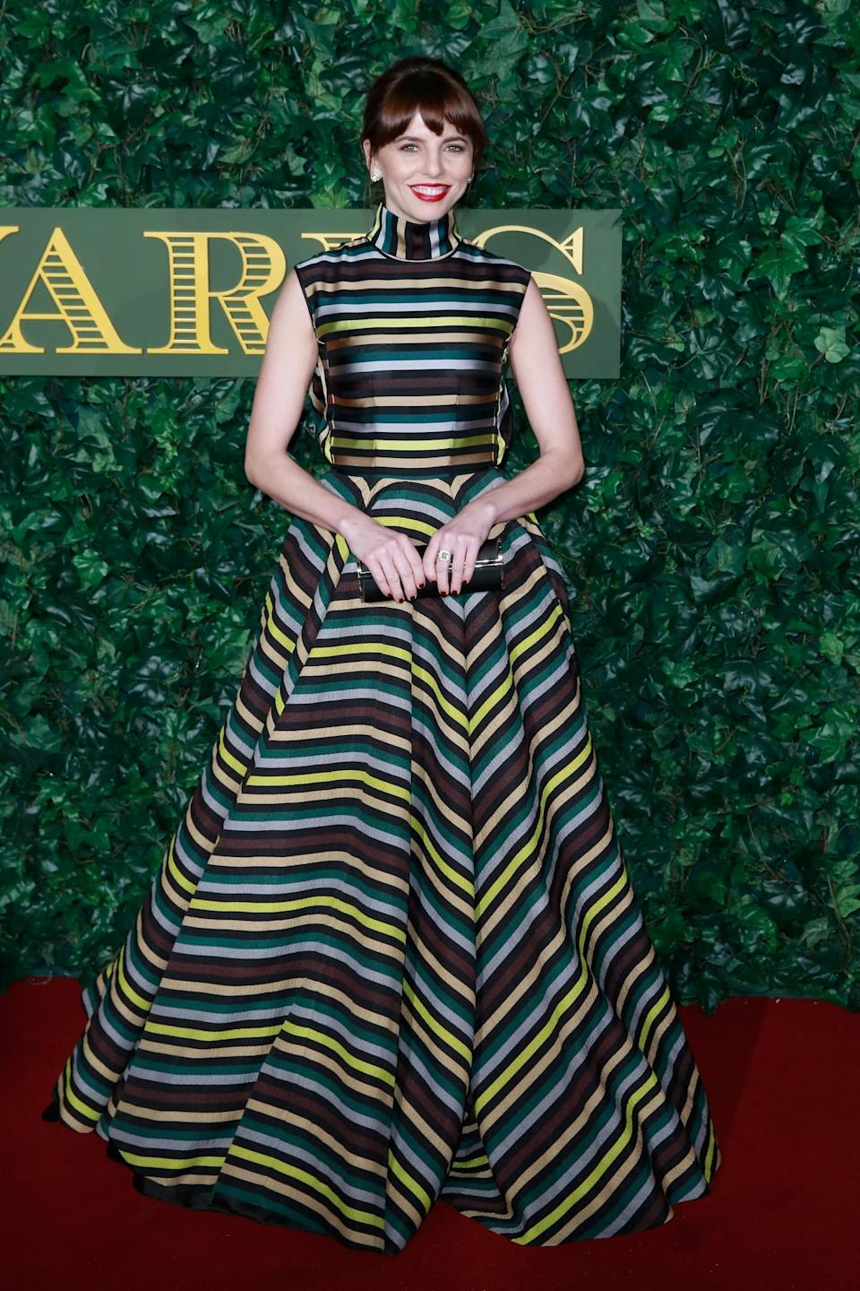 <p>Ophelia was simply stunning in a striped gown that would be worthy of a much bigger event. The actress proved that sometimes taking a risk pays off in droves. <i>[Photo: Getty]</i> </p>