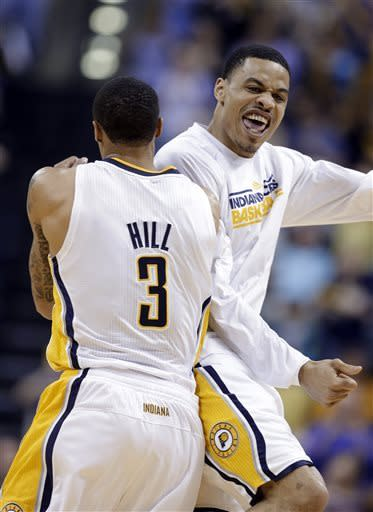 Indiana Pacers guard George Hill, left, and forward Gerald Green celebrate as the Pacers took the lead against the Cleveland Cavaliers late in the second half of an NBA basketball game in Indianapolis, Tuesday, April 9, 2013. The Pacers won 99-94. (AP Photo/Michael Conroy)