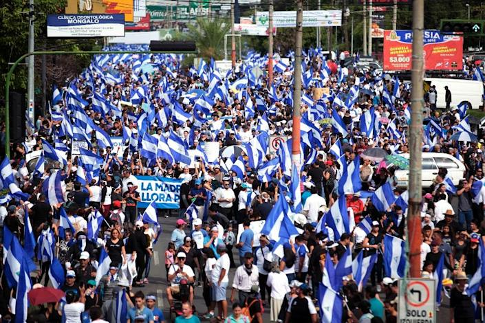 """Anti-government protesters take part in a march in support of """"the Mothers of April"""" movement -- whose children died in the protests -- on Nicaragua's National Mother's Day, in Managua earlier this week (AFP Photo/DIANA ULLOA)"""