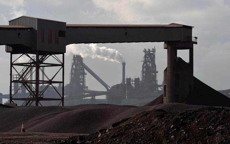 Scunthorpe steel plant seen across mounds of coal - Credit: PA Wire/Anna Gowthorpe