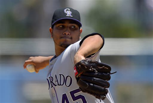 Colorado Rockies starting pitcher Jhoulys Chacin throws to the plate during the first inning of their baseball game against the Los Angeles Dodgers, Sunday, July 14, 2013, in Los Angeles. (AP Photo/Mark J. Terrill)