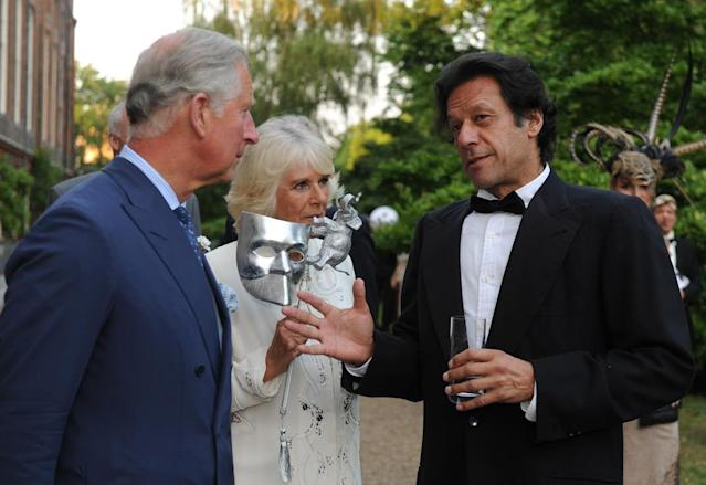 LONDON, UNITED KINGDOM - JULY 09: (L-R) Prince Charles, Prince of Wales and Camilla, Duchess of Cornwall meet with politician and former cricketer Imran Khan as they host a reception for the Elephant Family, a charity working to save the Asian Elephant from extinction in the wild, at Clarence House on July 09, 2013 in London, England. (Photo by Anthony Devlin - WPA Pool/Getty Images)