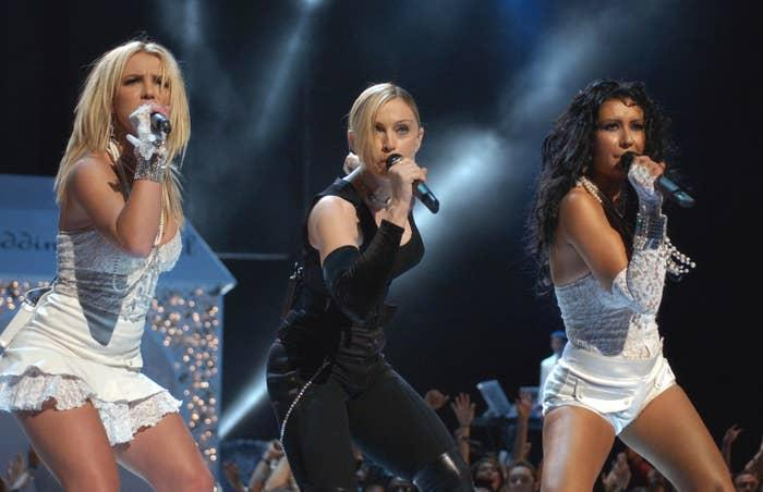 Singers Britney Spears(L), Madonna, and Christina Aguilera perform onstage during the 2003 MTV Video Music Awards at Radio City Music Hall on August 28, 2003 in New York City.