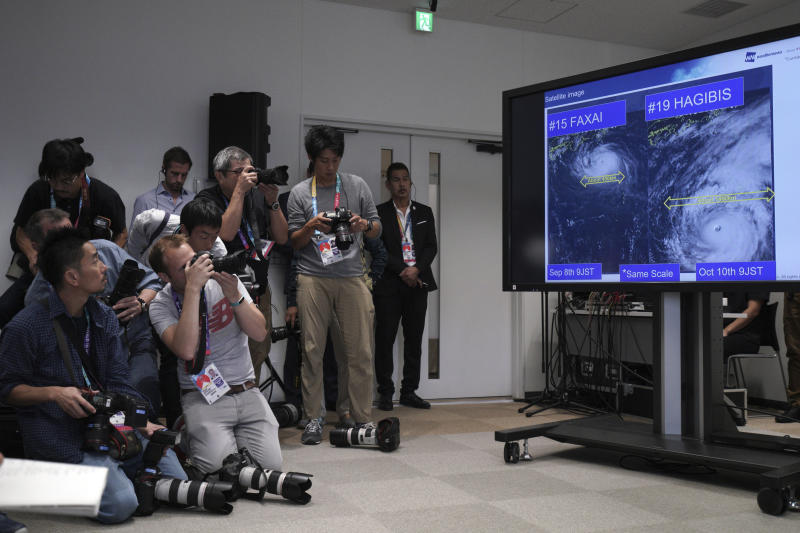 A satellite photo of typhoon Hagibis is seen during a press briefing on update relating to the anticipated impact of Typhoon Hagibis on the final round Rugby World Cup 2019 pool matches this weekend Thursday, Oct. 10, 2019, in Tokyo. (AP Photo/Eugene Hoshiko)