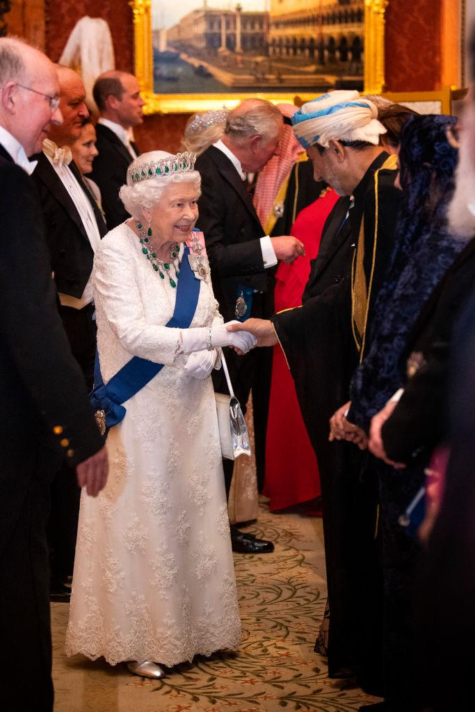 The Queen looked timeless in a white gown by Angela Kelly [Photo: Getty]