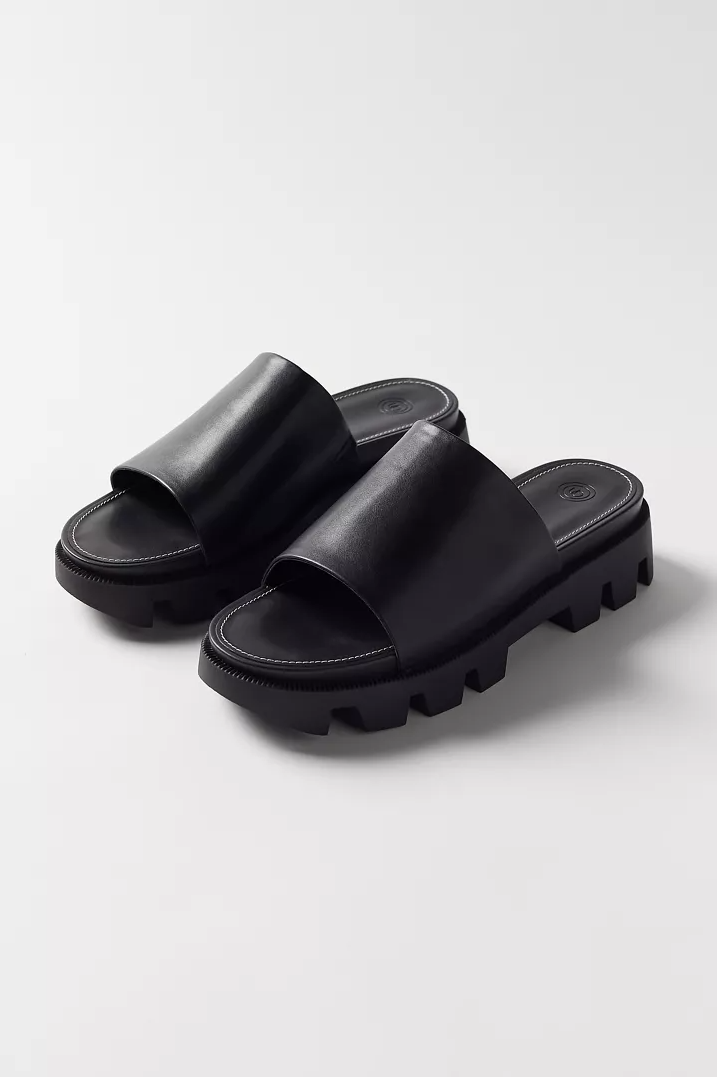 "<h2>Urban Outfitters Roxy Slide Sandals</h2><br><em>Shop sandals at <strong><a href=""https://www.urbanoutfitters.com/womens-sandals"" rel=""nofollow noopener"" target=""_blank"" data-ylk=""slk:Urban Outfitters"" class=""link rapid-noclick-resp"">Urban Outfitters</a></strong></em><br><br><strong>Urban Outfitters</strong> Roxy Chunky Slide Sandal, $, available at <a href=""https://go.skimresources.com/?id=30283X879131&url=https%3A%2F%2Fwww.urbanoutfitters.com%2Fshop%2Fuo-roxy-chunky-slide-sandal%3Fcolor%3D001%26type%3DREGULAR%26quantity%3D1"" rel=""nofollow noopener"" target=""_blank"" data-ylk=""slk:Urban Outfitters"" class=""link rapid-noclick-resp"">Urban Outfitters</a>"