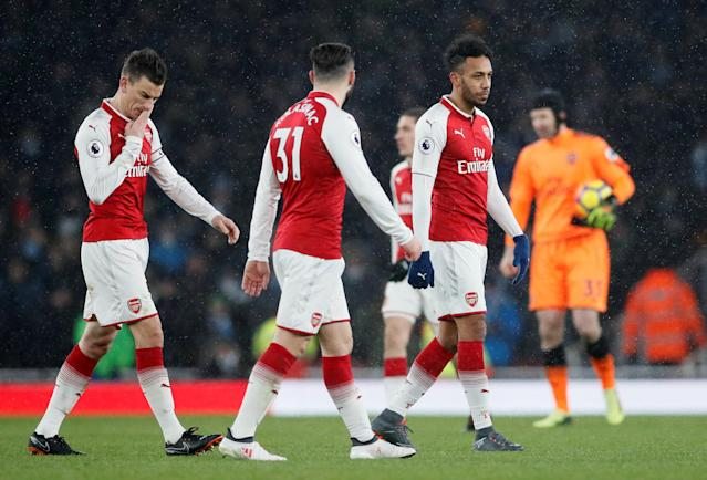 """Soccer Football - Premier League - Arsenal vs Manchester City - Emirates Stadium, London, Britain - March 1, 2018 Arsenal's Laurent Koscielny and Pierre-Emerick Aubameyang look dejected after the match REUTERS/David Klein EDITORIAL USE ONLY. No use with unauthorized audio, video, data, fixture lists, club/league logos or """"live"""" services. Online in-match use limited to 75 images, no video emulation. No use in betting, games or single club/league/player publications. Please contact your account representative for further details."""