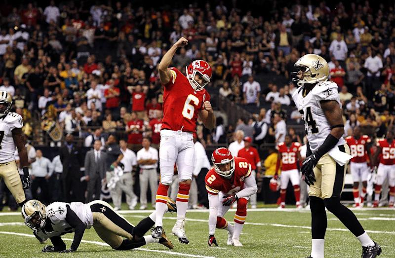 Kansas City Chiefs kicker Ryan Succop (6) celebrates his game-winning field goal as New Orleans Saints cornerback Patrick Robinson (21) falls to the turf in overtime of an NFL football game in New Orleans, Sunday, Sept. 23, 2012. The Chiefs won 27-24. (AP Photo/Jonathan Bachman)