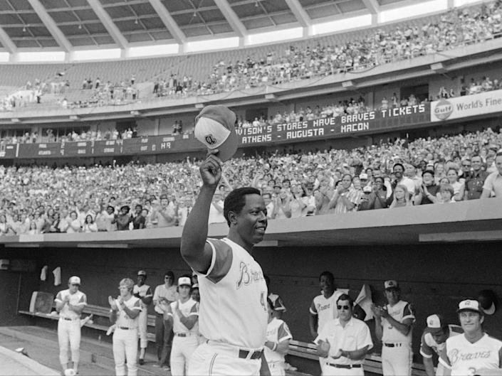 <p>Hank Aaron of the Atlanta Braves reacts Saturday, on 21 July 21 1973, in Atlanta after hitting 700th career home run against the Philadelphia Phillies</p> ((Associated Press))