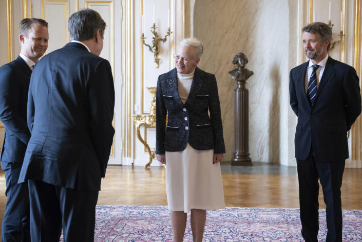 Denmark's Queen Margrethe II, left and Crown Prince Frederik, right, welcome US Secretary of State Antony Blinken, foreground, at Amalienborg Palace in Copenhagen, Denmark, Monday, May 17, 2021. Blinken is seeing Danish leaders as well as top officials from Greenland and the Faeroe Islands in Copenhagen on Monday before he heads to Iceland for an Arctic Council meeting that will be marked by his first face-to-face talks with Russian Foreign Minister Sergey Lavrov at a time of significantly heightened tensions between Washington and Moscow. (Saul Loeb/Pool Photo via AP)