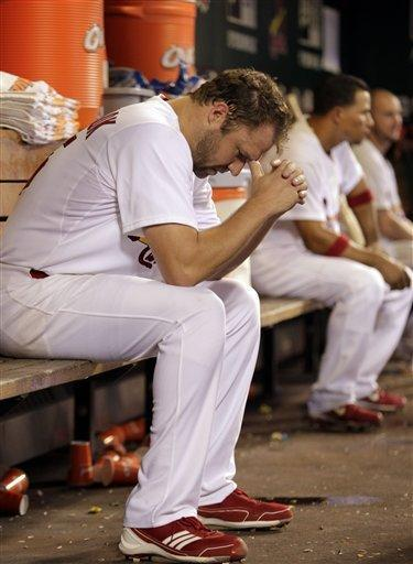 St. Louis Cardinals starting pitcher Jake Westbrook sits in the dugout in the sixth inning of a baseball game against the Cleveland Indians, Friday, June 8, 2012 in St. Louis. Westbrook lasted six innings, giving up four runs on eight hits. (AP Photo/Tom Gannam)