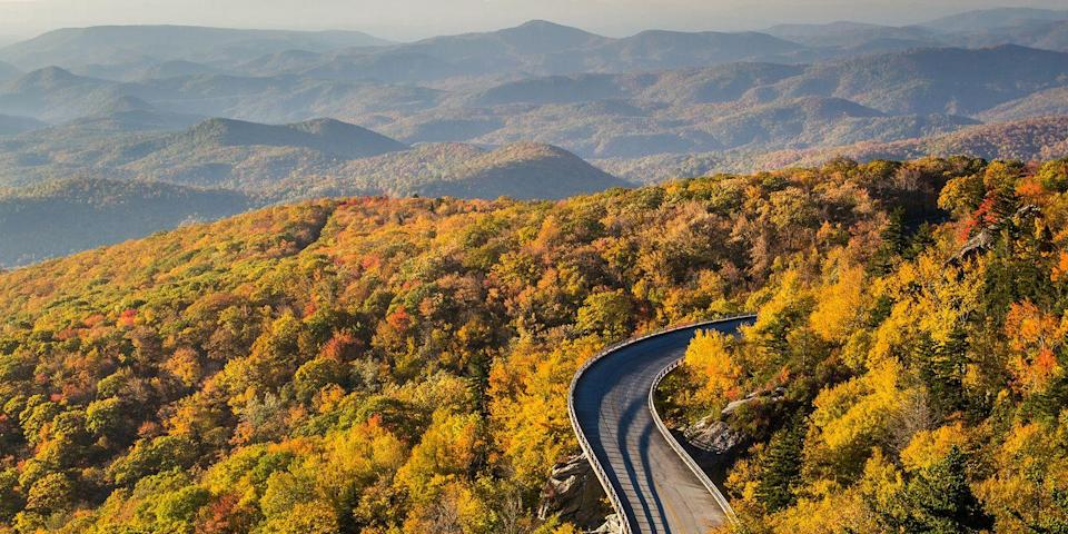 """<p>Immerse yourself in the beautiful scenery of southern Appalachia with a drive along the <a href=""""https://www.tripadvisor.com/Attraction_Review-g1438847-d108327-Reviews-Blue_Ridge_Parkway-North_Carolina_Mountains_North_Carolina.html"""" rel=""""nofollow noopener"""" target=""""_blank"""" data-ylk=""""slk:Blue Ridge Parkway"""" class=""""link rapid-noclick-resp"""">Blue Ridge Parkway</a>, a 469-mile scenic road. One of the most popular sections is the 80-mile stretch that starts out in the bohemian city of Asheville and passes the parkway's highest peaks, including Mount Pisgah and Balsam Knob, before ending in <a href=""""https://www.bestproducts.com/fun-things-to-do/g2543/best-national-parks-for-hiking/"""" rel=""""nofollow noopener"""" target=""""_blank"""" data-ylk=""""slk:Great Smoky Mountains National Park"""" class=""""link rapid-noclick-resp"""">Great Smoky Mountains National Park</a>.</p>"""