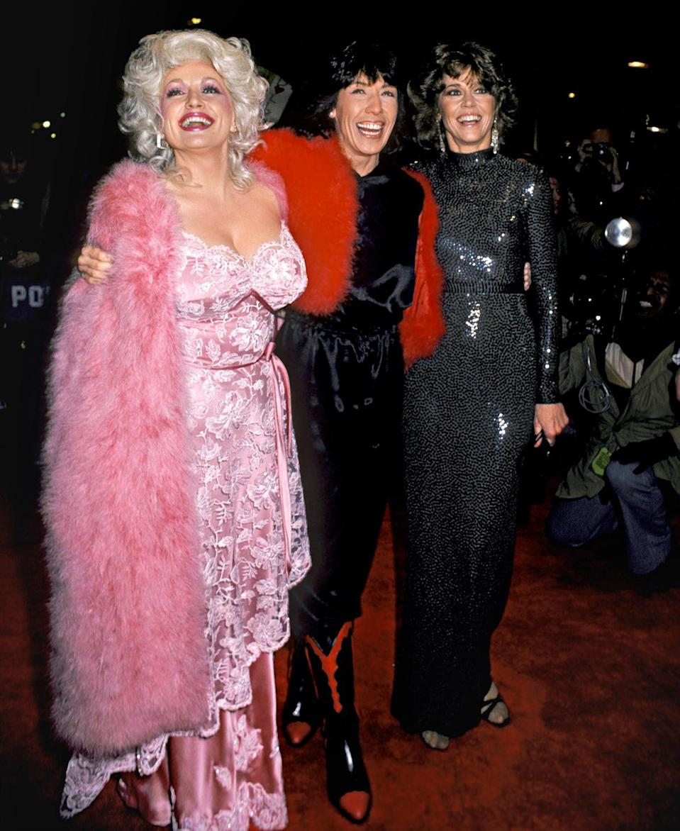 """<p>In 1980, Parton (with costars Lily Tomlin and Jane Fonda) had <em>9 to 5</em> costume designer Ann Roth make her pink embroidered dress for the movie premiere: """"I needed to be fancy, and I didn't know how to do that.""""</p>"""